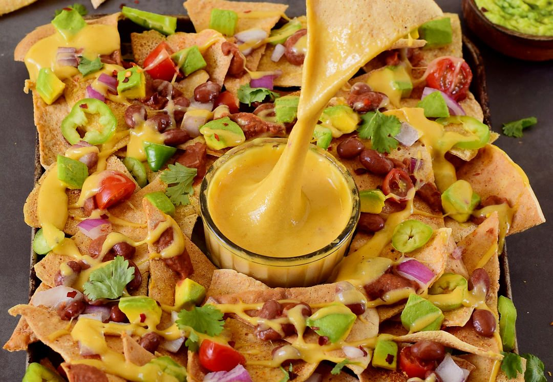 Easy Vegan Cheese Sauce With Minimal Ingredients And Ready In 3 Minutes A Super Simple Vega Vegan Cheese Sauce Recipe Vegan Cheese Sauce Vegan Mexican Recipes