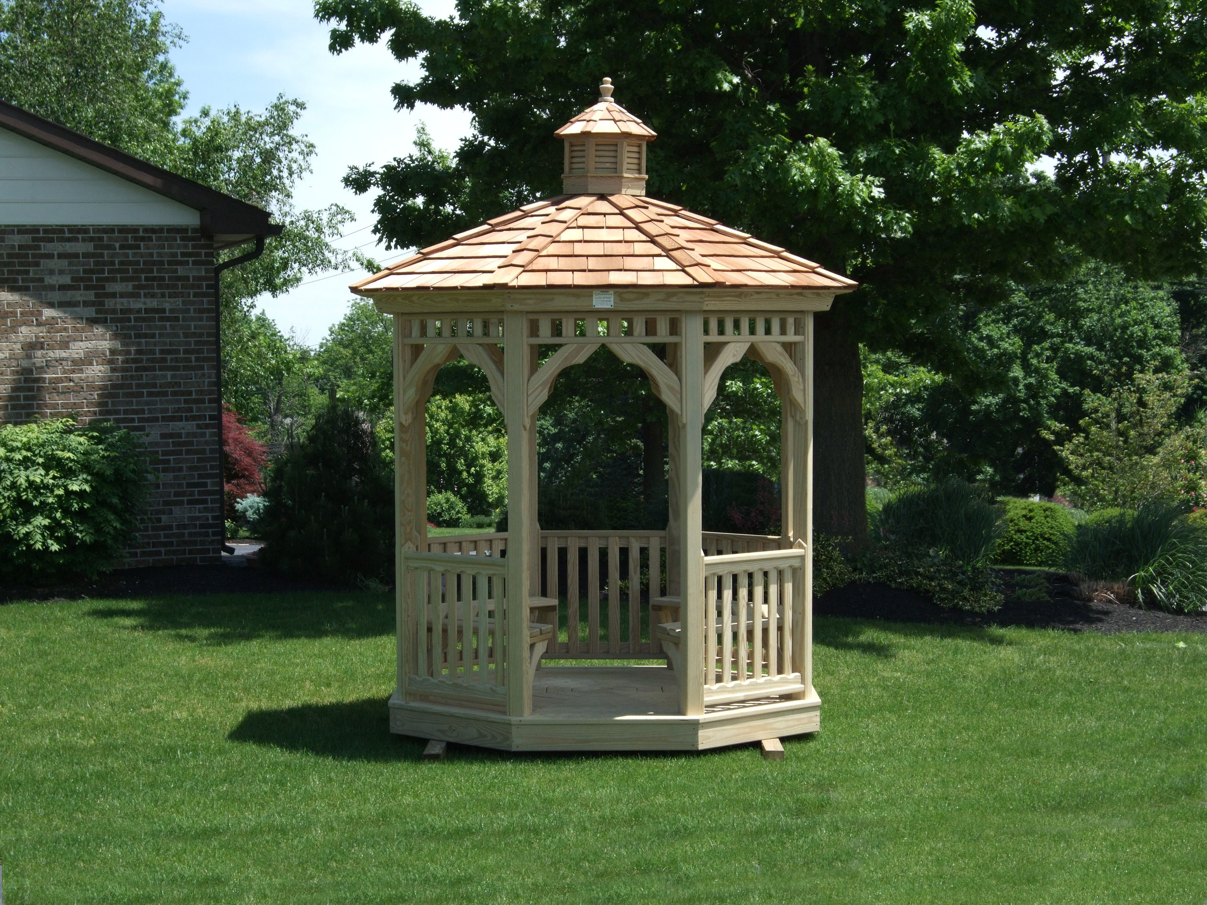 a small and beautiful octagon gazebo with wood cedar shake roof