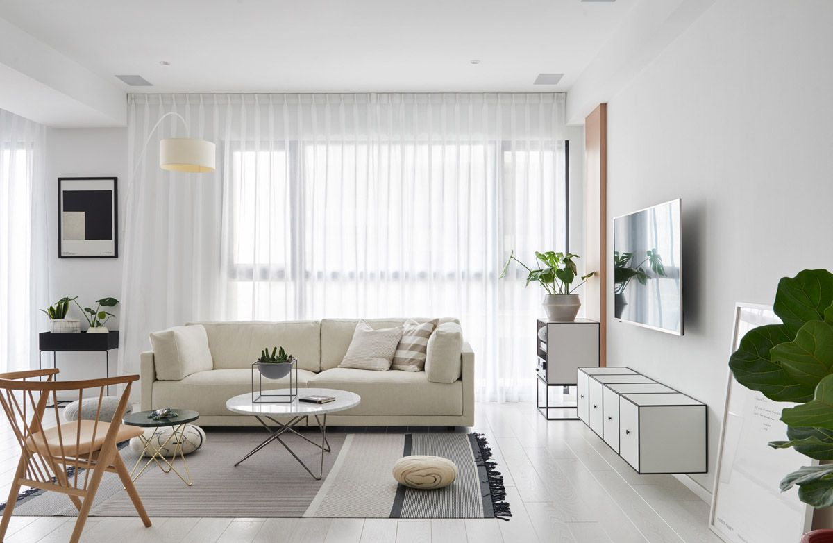 Black White And Patterns Steal The Show In This Scandinavian Style Apartment Living Room Scandinavian Apartment Living Room One Bedroom Apartment