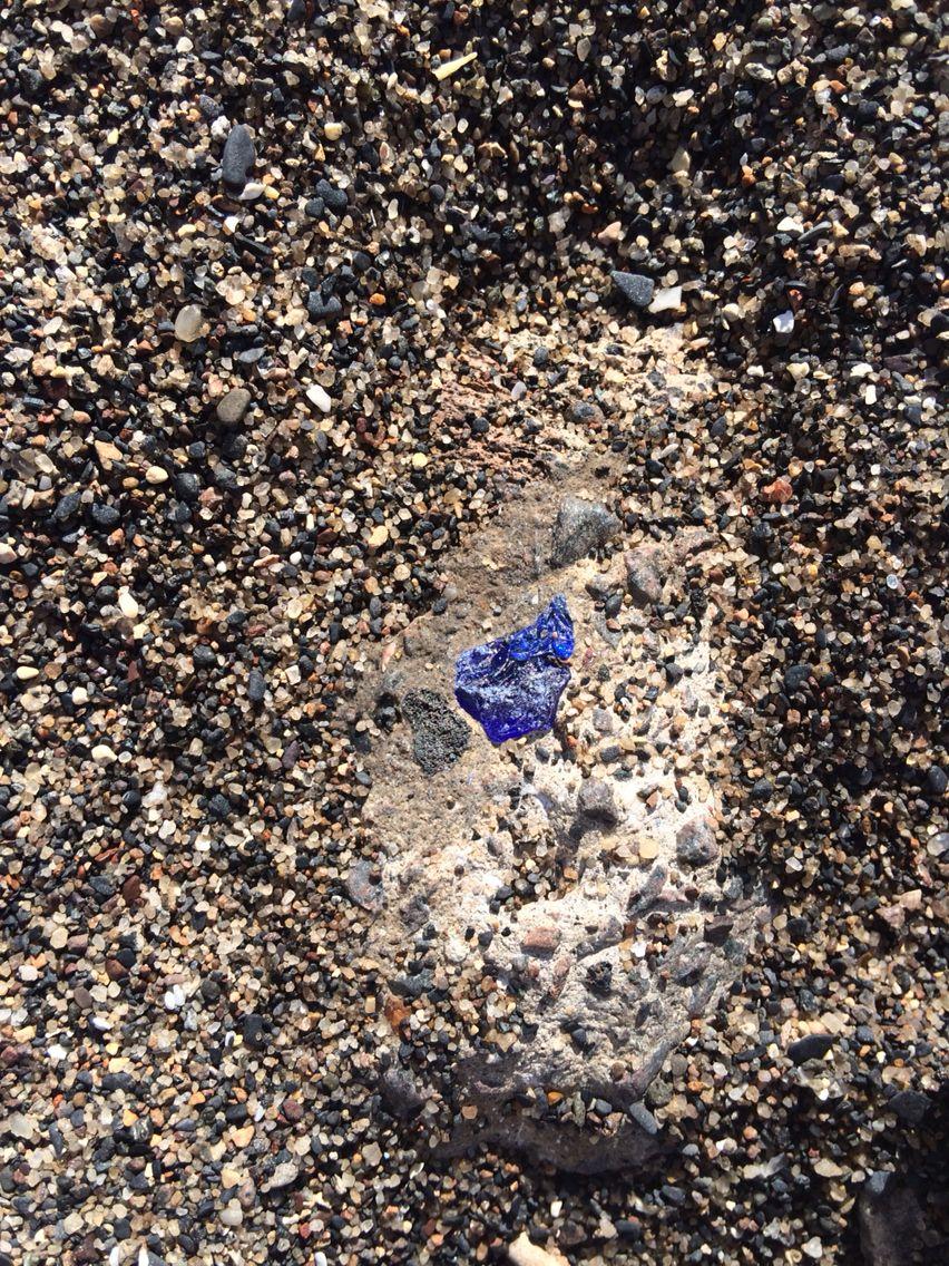Blue sea glass in rock