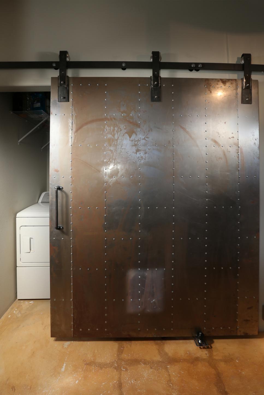 A Custom Designed Metal Door Slides On A Barn Door Track System To