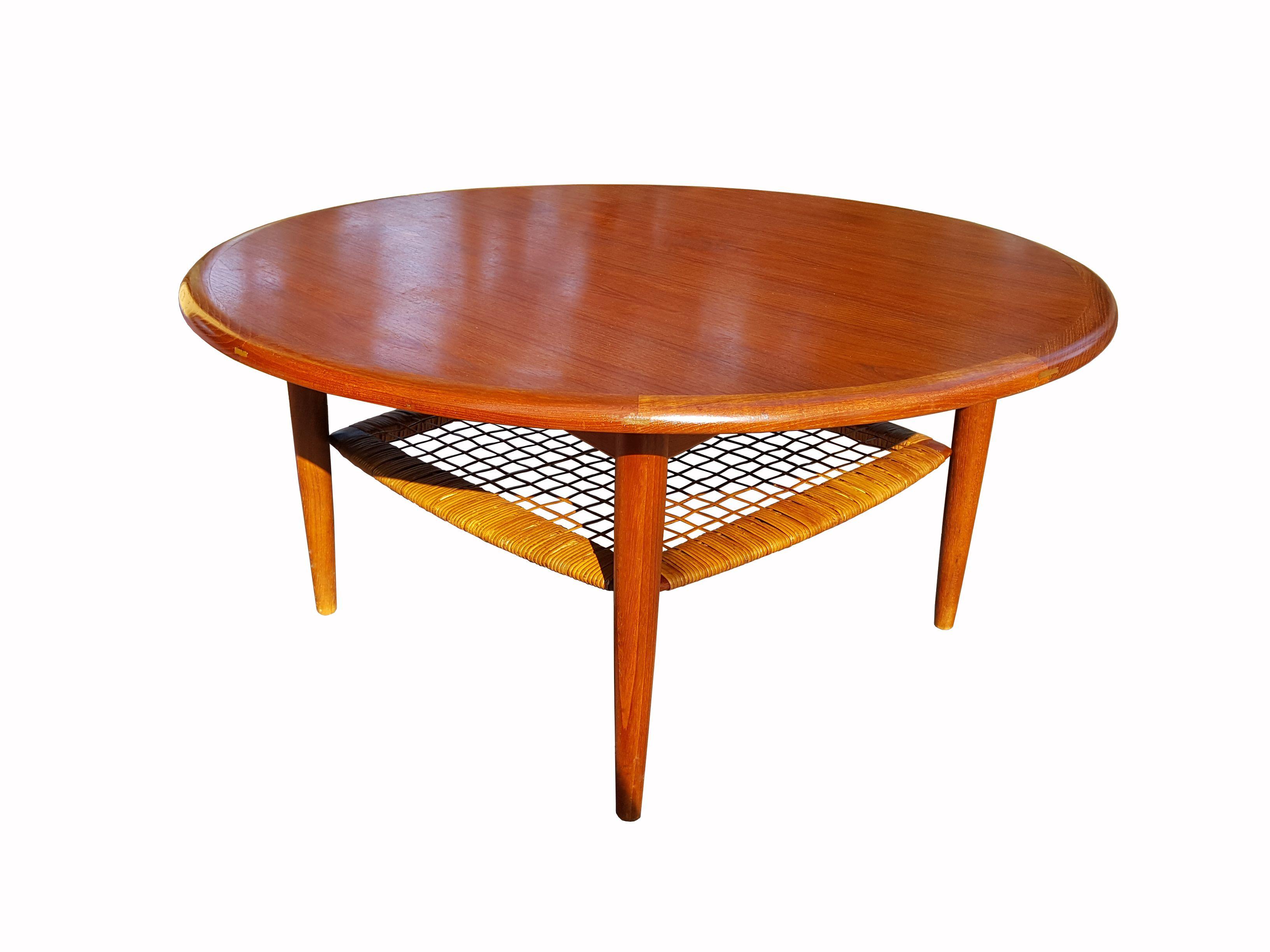Danish mid century modern teak coffee table with cane shelf by