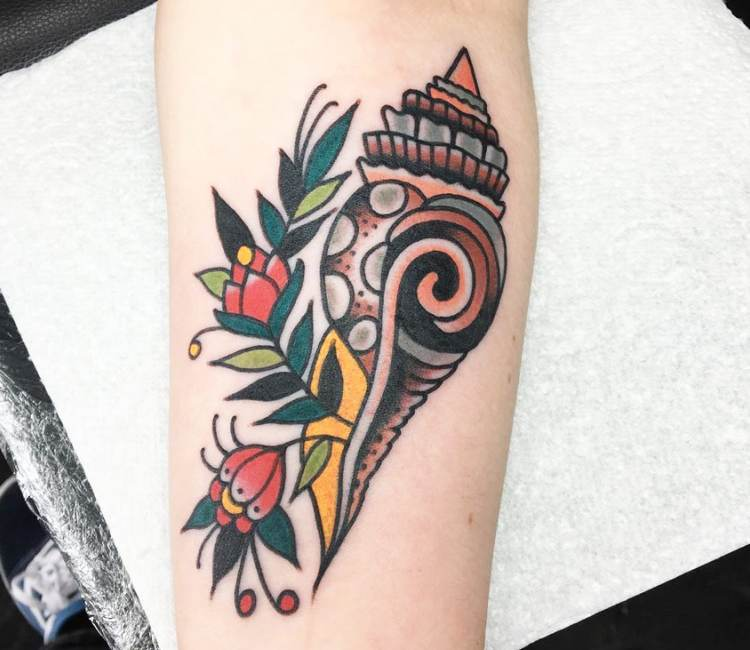 Shell and floral tattoo by Sam Ricketts