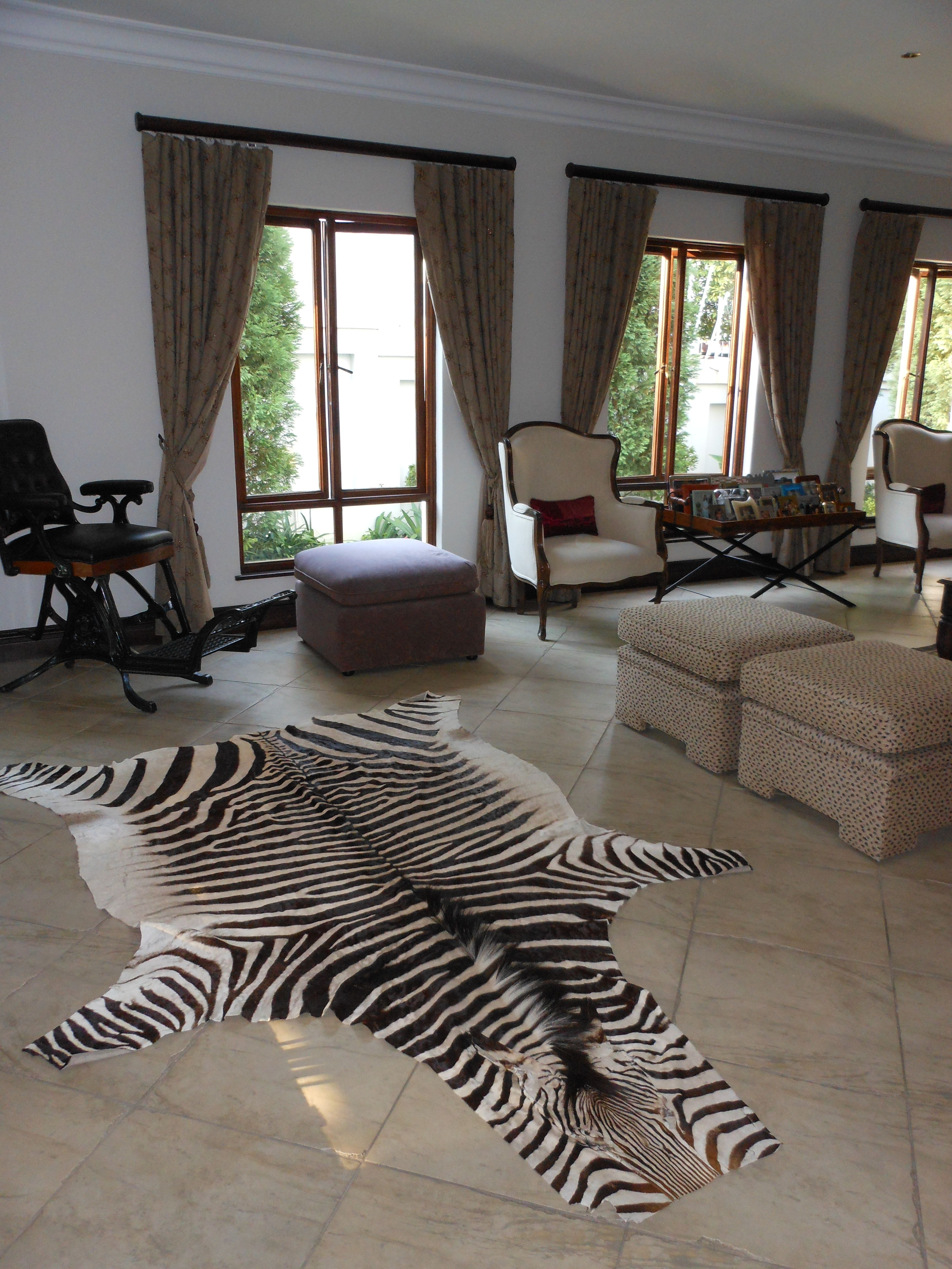 Zebra Skin Decor By Instyle Indulgence Interiors African Home Decor Living Decor South African Decor #zebra #living #room #decor