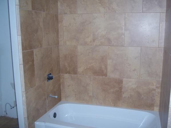 18 X 18 Tile For Our Tub Surround And We Paid Next To Nothing Bathtub Surround Bathtub Tile Bathrooms Remodel