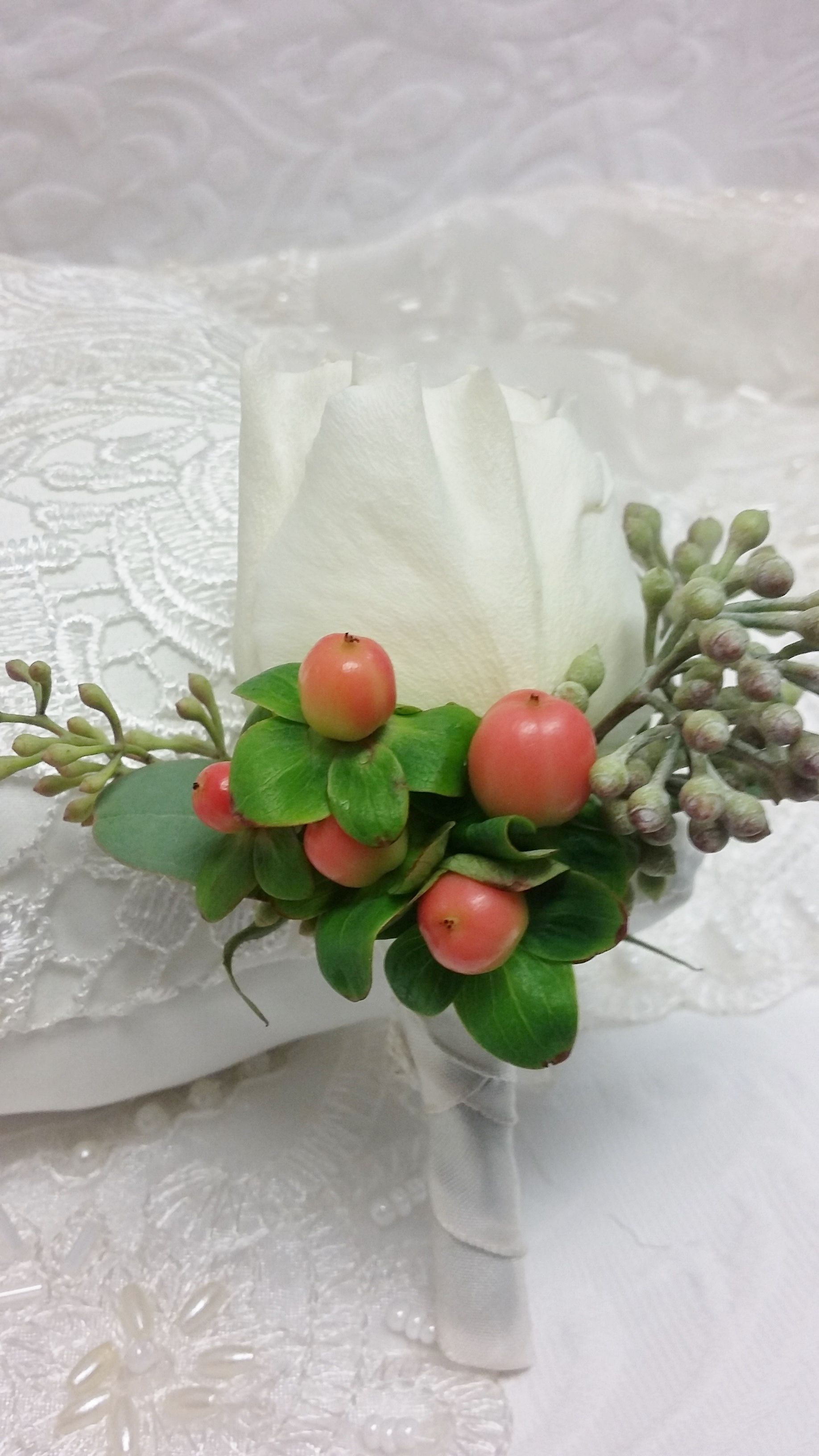 White Garden Rose Boutonniere white garden rose boutonniere with coral hypericum berries and
