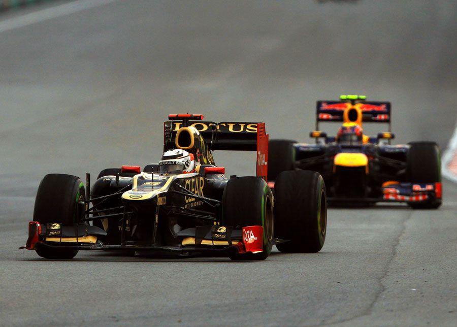 F1 Malaysia GP - Kimi Raikkonen leads Mark Webber on a drying track