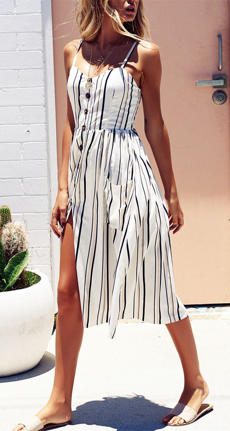 14ac0099b2 Mid calf dress featuring striped pattern and spaghetti straps, with  single-breasted and two big pockets design, a good choice for summer and beach  wear.