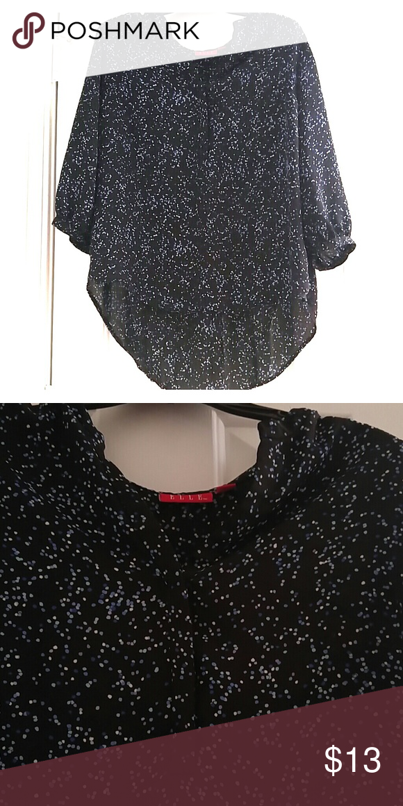Elle speckled blouse Blouse is all black with specks of light blue, purple,blue, and cream! Great addition to you work attire! The front part has a v shape down with three buttons. Elle Tops Blouses