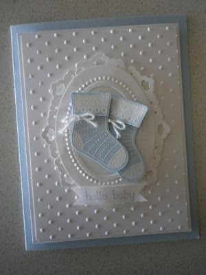 Ink: Blue (Bashful).  Used the Doily Triple Layer Punch to frame the Largest Oval die cut from Ovals Original Die scallop frame. 4 Doily's cut in half & adhered to the back of the Oval.  Stitched Stocking Stamp set & matching punch.