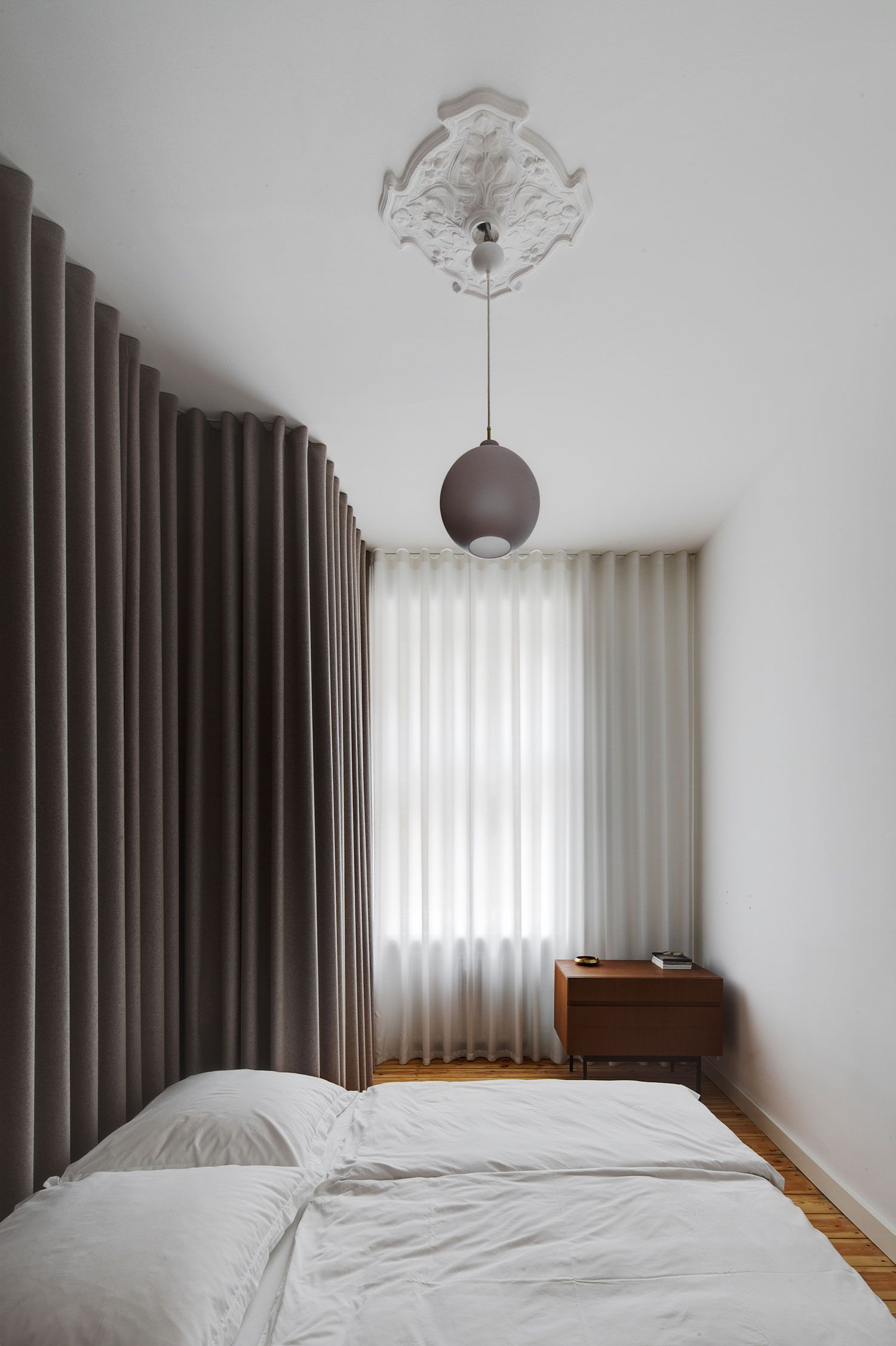 Berlin Mitte Apartment Refurbishment by Atheorem   Yellowtrace bedroom covered in curtains