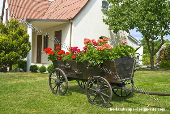 Google Image Result For Http Www The Landscape Design Site Com Gardendecor Images Spoke Wheel Wagon Yard Garden Deco Garden Yard Ideas Xeriscape Landscaping