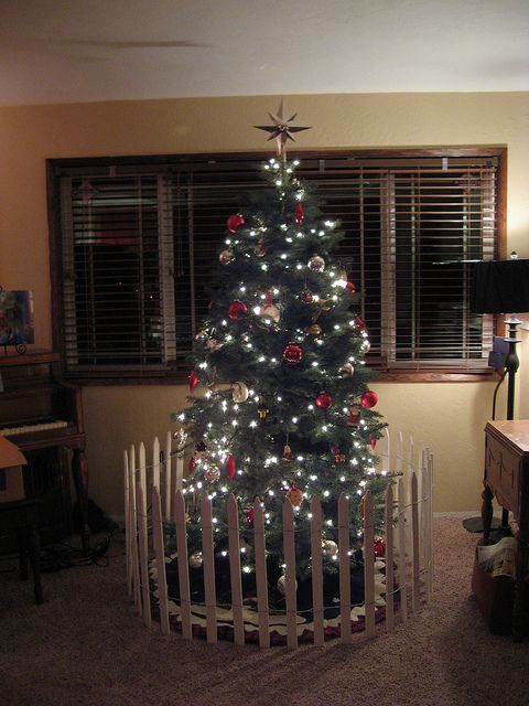 Toddler Proofing The Tree Cheap Picket Fence From Lowe S Could Also Add Some Glitter And Snow To Make Christmas Tree Fence Diy Christmas Tree Christmas Tree