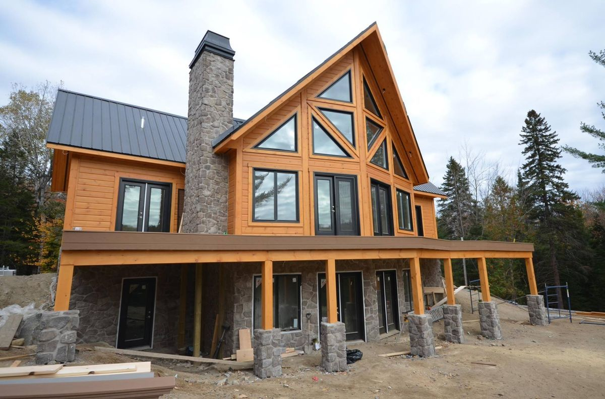 Image result for log cabin with black metal roof (With