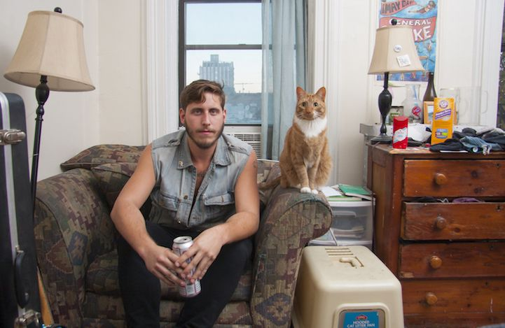"""David Williams breaks the """"crazy cat lady"""" stereotype by photographing grown men with their adorable cats."""