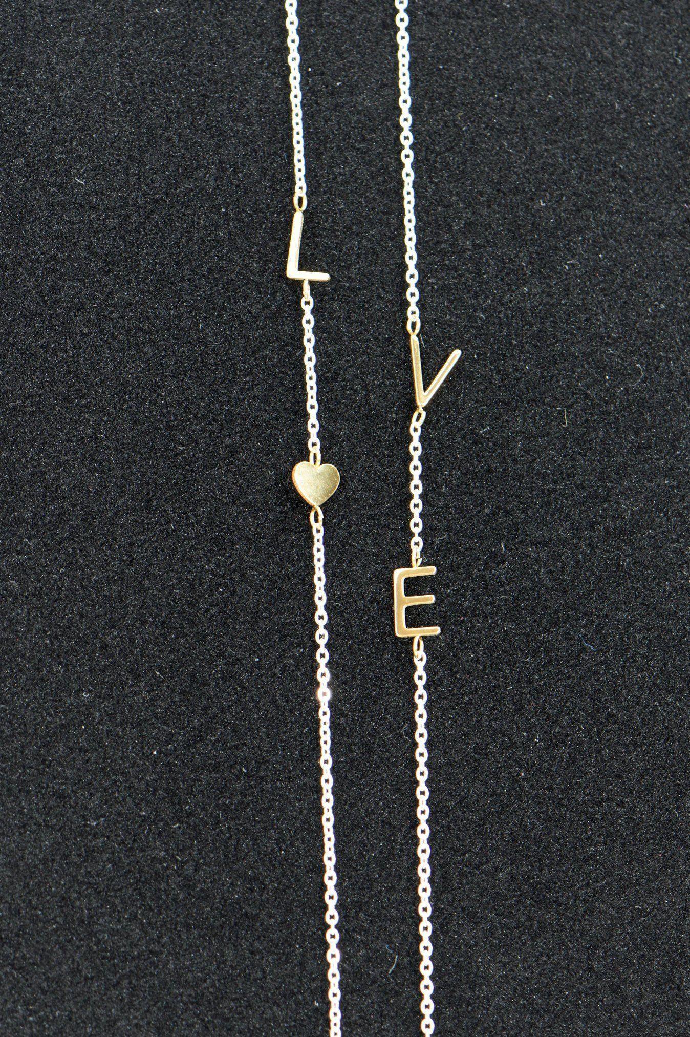 12++ Sideways letter necklace silver trends