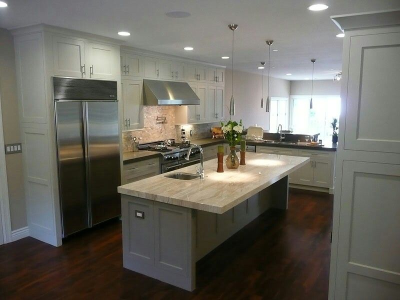 Dark wood floors grey island white cabinets light counters White cabinets grey walls