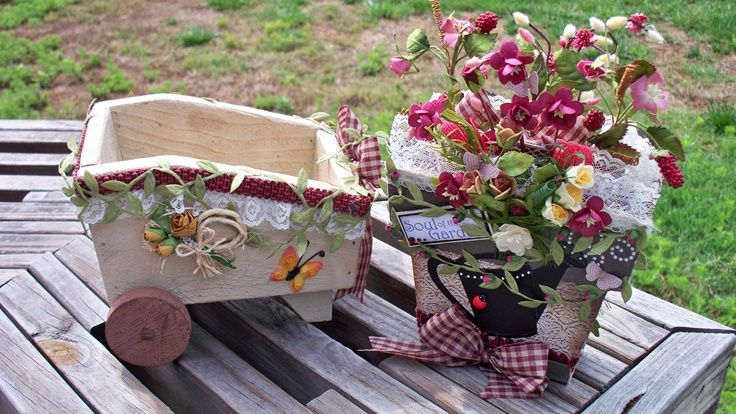 Altered wooden wheel barrow with pot shaped chipboard mini album
