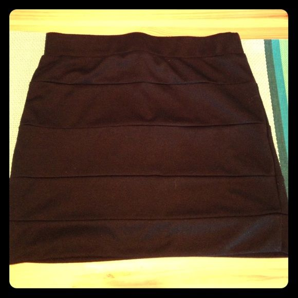 Boutique mini skirt Black mink skirt, thicker fabric with some stretch. Slight pilling on waistband and bottom of skirt but otherwise in great condition. Lush Skirts Mini