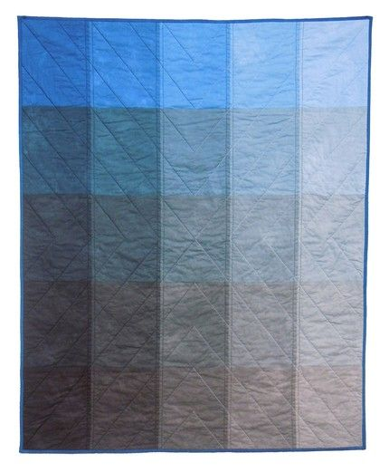 This is great. Paint chip quilt in blue.  Love the quilting.