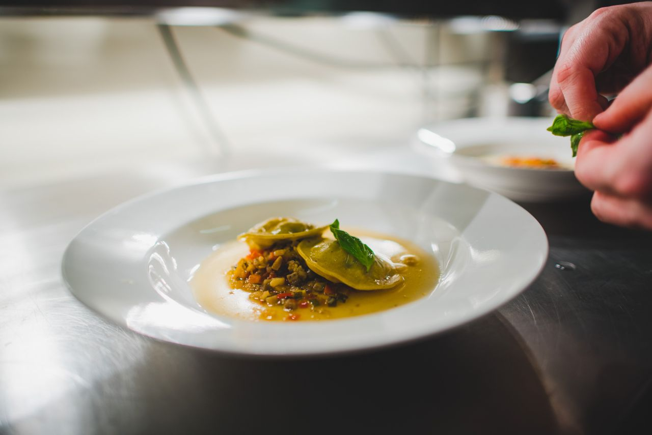 Ratatouille Filled Ravioli With A Warm Tomato Consomme Provided By Unique Norfolk Venues