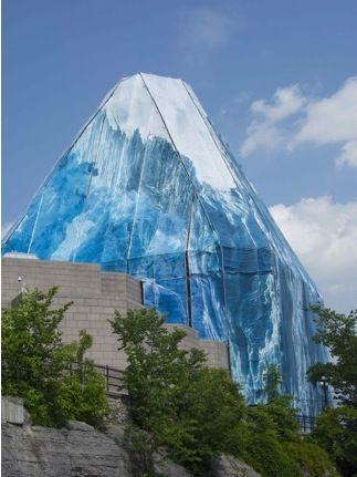 """Iceberg, 2013, National Art Gallery, Ottawa, Canada. """"On the way back to Ontario, I pass the art museum where a Greenland artist had covered a large part of the museum with printed tarps that turn it into a melting iceberg. A timely reminder and gorgeous—you can see it from all over town."""""""