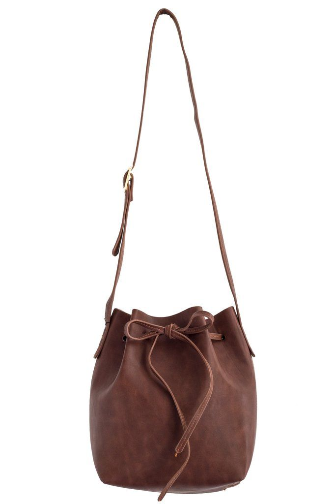 """The Whitney is a gorgeous, structured take on the bucket bag which means it effortlessly transitions through seasons and styles. Dimensions: Small measures 8.5"""" in depth, 10.5"""" in width at opening, 4"""""""