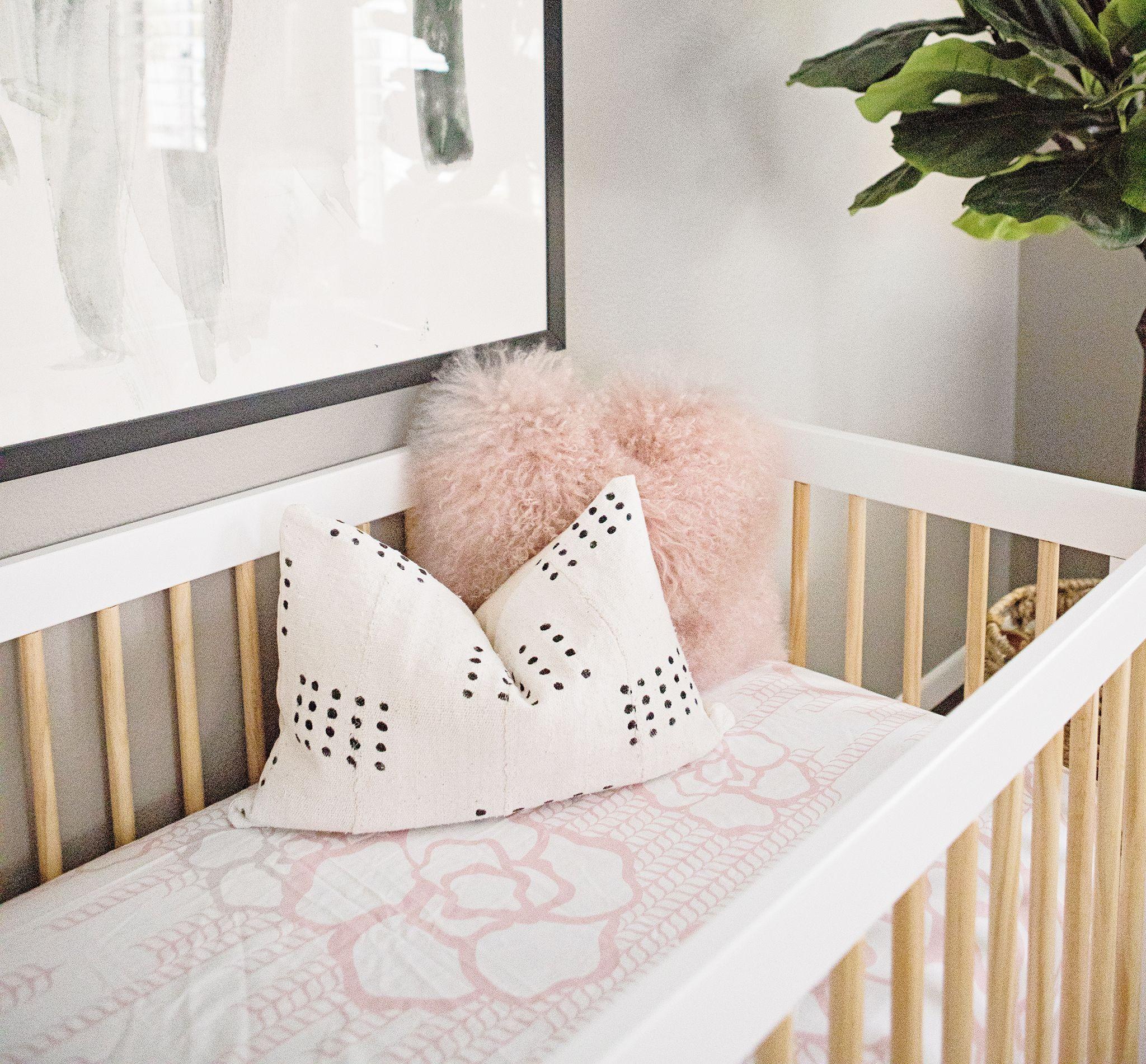 celebrity design reveal tamera mowry's nursery  white crib  - find the bedding in the project nursery shop  oilo capri crib bedding in
