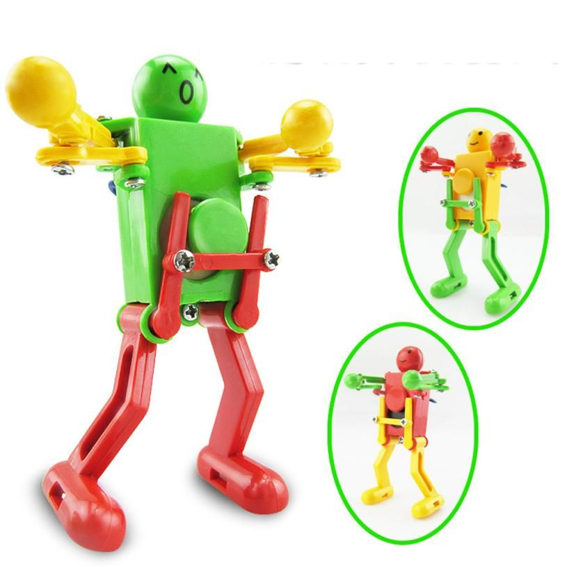 Spring Wind-up Girls Boys Walking Clockwork Gift Toy Dancing Robot Children
