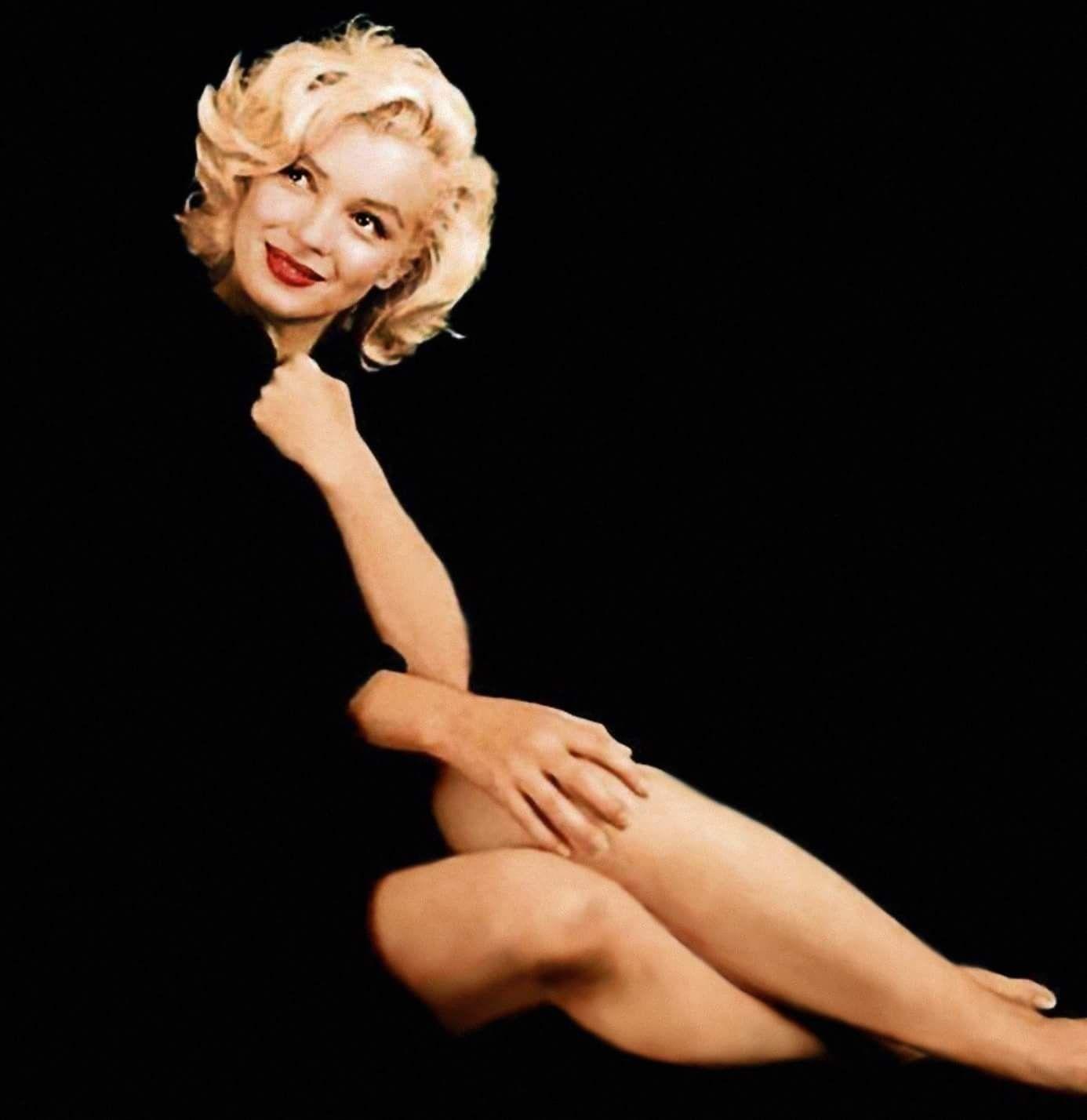 Marilyn Black cardigan sitting Photo by Milton Greene Ms