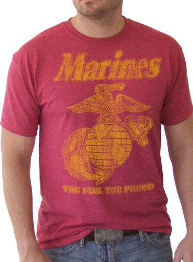 This soft cotton shirt has a vintage look and is available in heather red or olive drab. Features the Marine Corps Eagle, Globe and Anchor above text The Few The Proud. Print is yellow on the heather red and black on the olive drab.