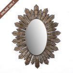 Sunburst mirror above bed hung horizontally