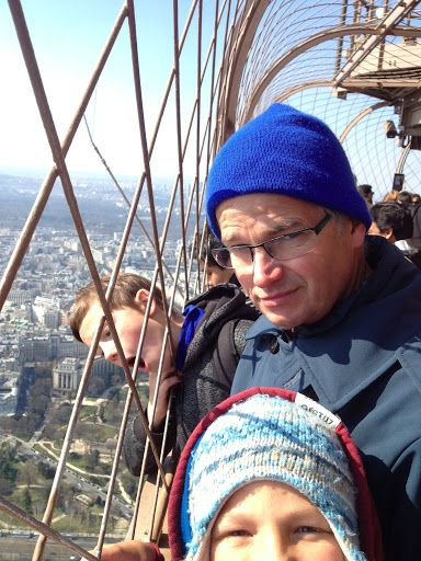 At the top of the tower, after waiting in line for an hour. We got off easy.