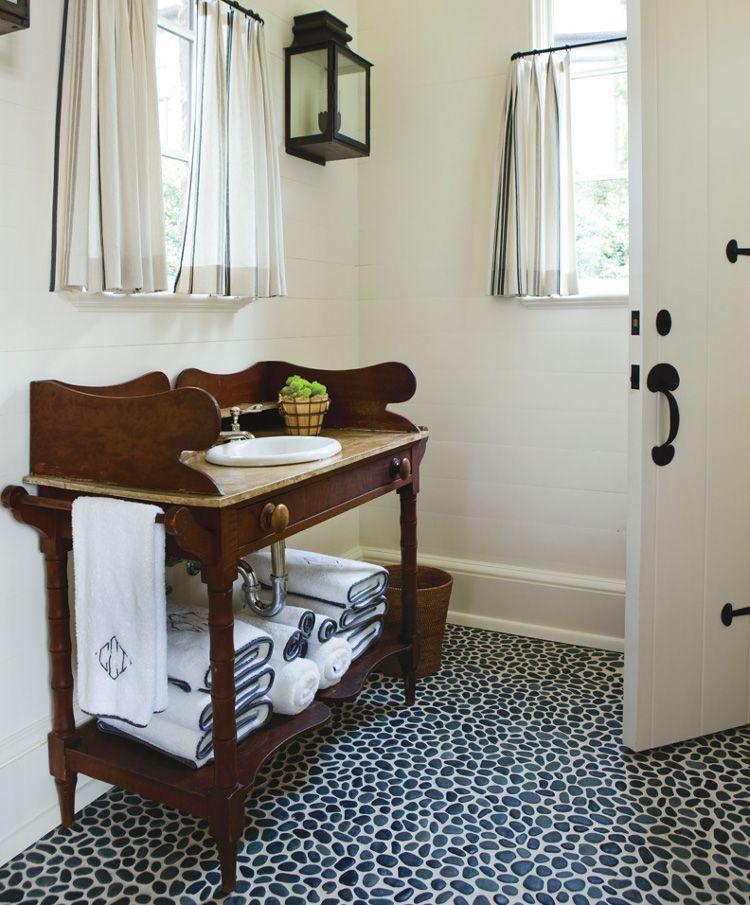 black pebble tile floor in an Atlanta pool house bath by Phoebe Howard - Atlanta Homes and Lifestyles via Atticmag