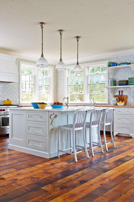 Familyfriendly beach house kitchen white with barn board floor
