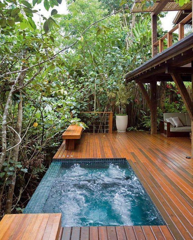 Dive Into This Zen Pool House With Rustic Flair: Cozy Modern Outdoor Bathtub Design Ideas 27