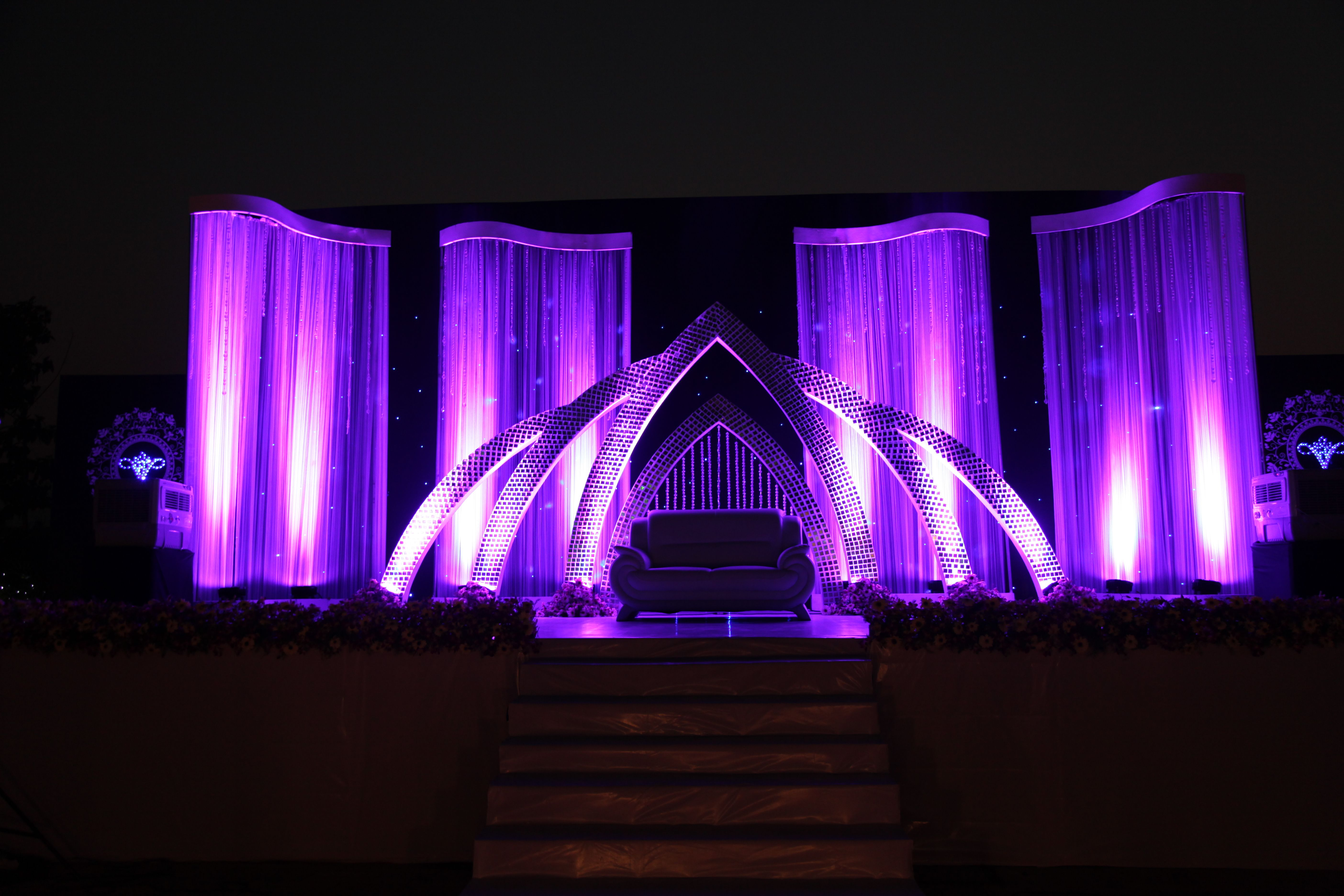 The purple themed mirror worked wedding reception stage for Background stage decoration