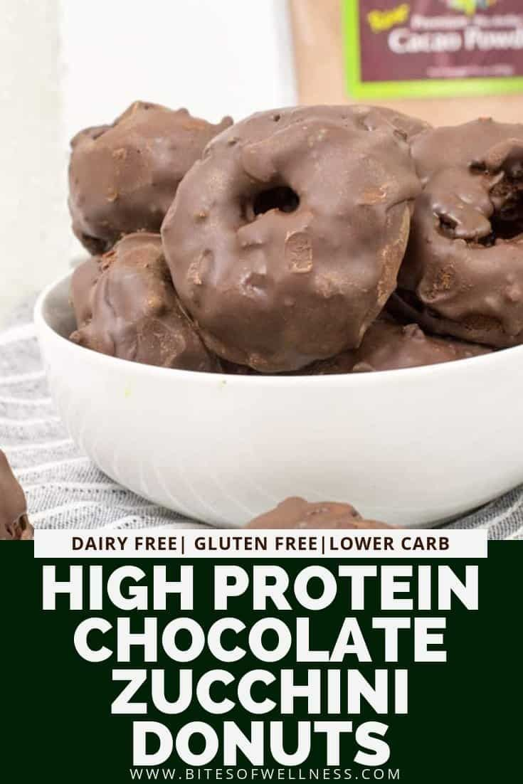 High protein Chocolate Zucchini Donuts are a healthy way to indulge your sweet tooth! This recipe is easy to make, gluten free, dairy free and made without added sugar! This clean eating recipe is made with shredded zucchini and protein powder to make them higher in protein and fiber, so you can feel good about eating them for dessert or an afternoon snack! Kids will love these too! via @bitesofwellness #proteindonuts
