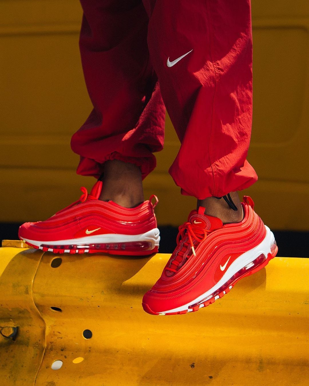 The NIKE WMNS AIR MAX 97 RED ORBIT sets itself apart from