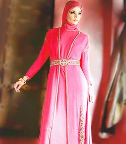 Jilbab: Pink crinkle chiffon double layered jilbab having embellished front opening and sleeves cuffs. Embellished belt on empire waist. One sided heavy embroidered bottom. Matching crinkle chiffon scarf has light embellishments.
