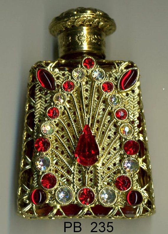 Glass Perfume Bottle- variegated orange bottle with gold filigree with red and…