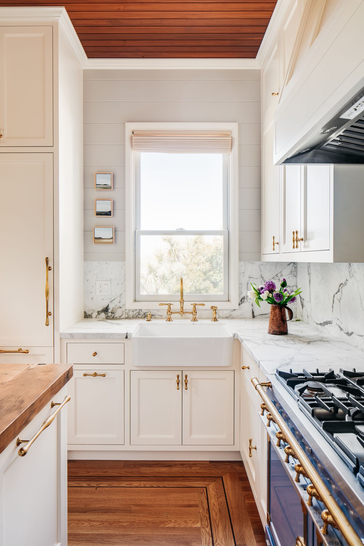 An antique white porcelain farmhouse sink and solid brass