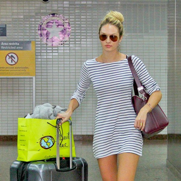 Candice Swanepoel managed to look perfectly put together in a striped mini dress paired with fabulous aviator shades after a long flight!