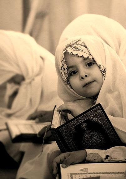 One of the cutest pics ever..a cute little girl reading the holy ...