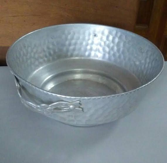 Check out this item in my Etsy shop https://www.etsy.com/listing/537750425/vintage-aluminum-bowl-hammered-metal