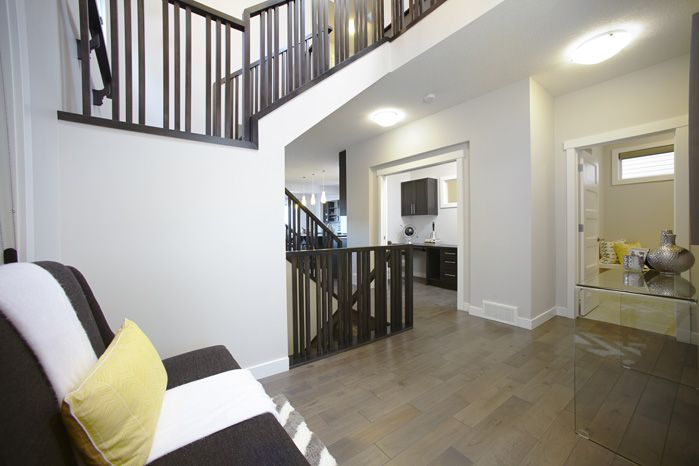 Two storey foyer / entry with adjacent IT centre in the Tofino II showhome in Hillcrest in Airdrie by Shane Homes.