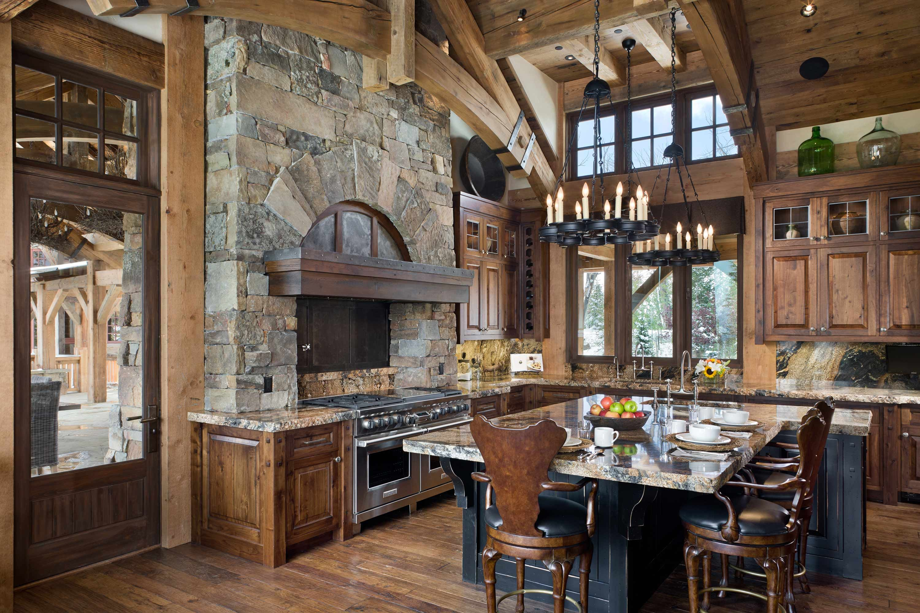 Summit Residence timber frame and stone kitchen at the Yellowstone ...