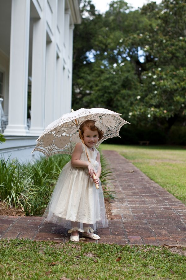 adorable flower girl, thinking maybe have them hold an umbrella and walk down with the boy holding the sign together.