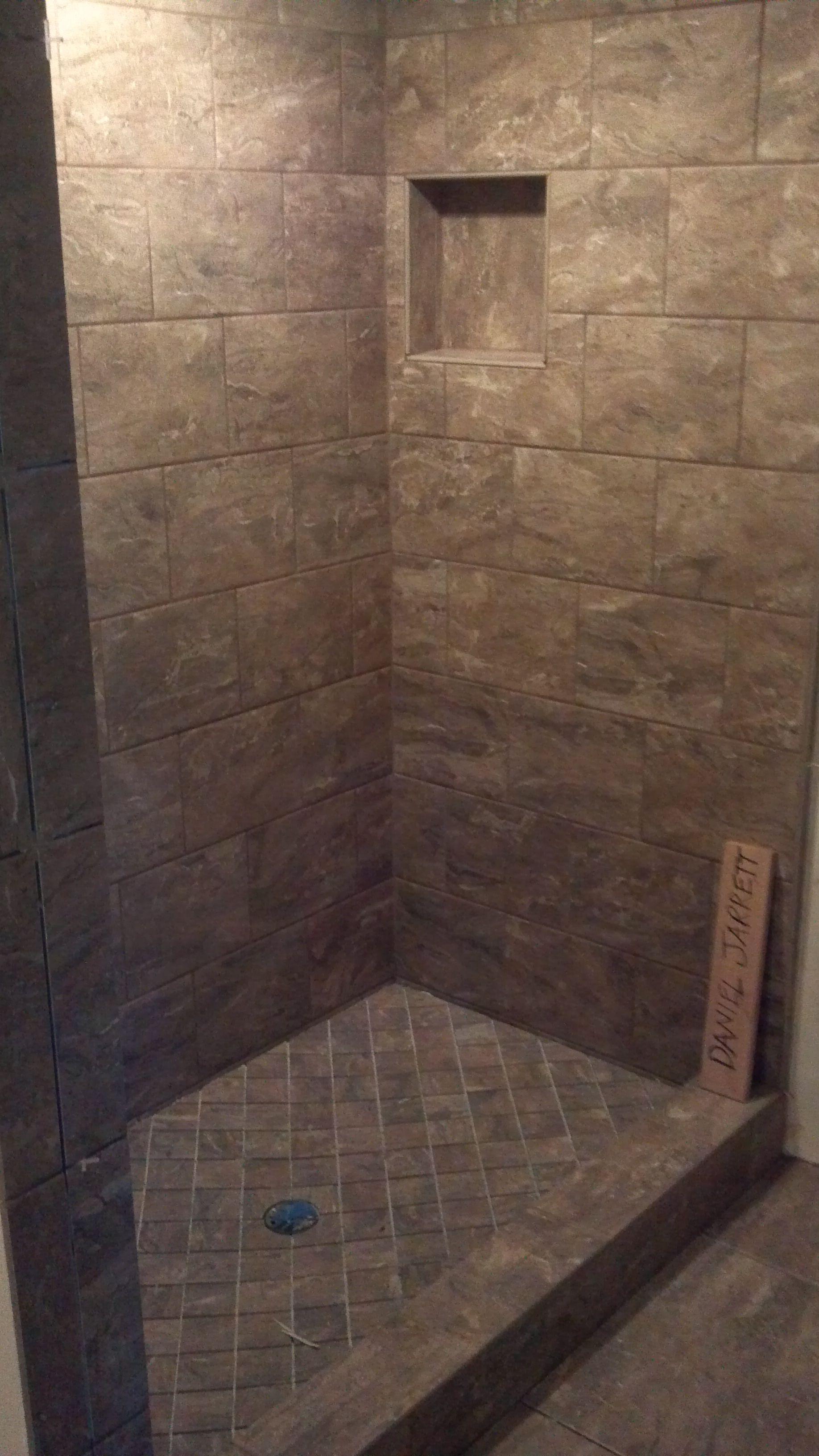 ceramic tile shower with sloped shower pan