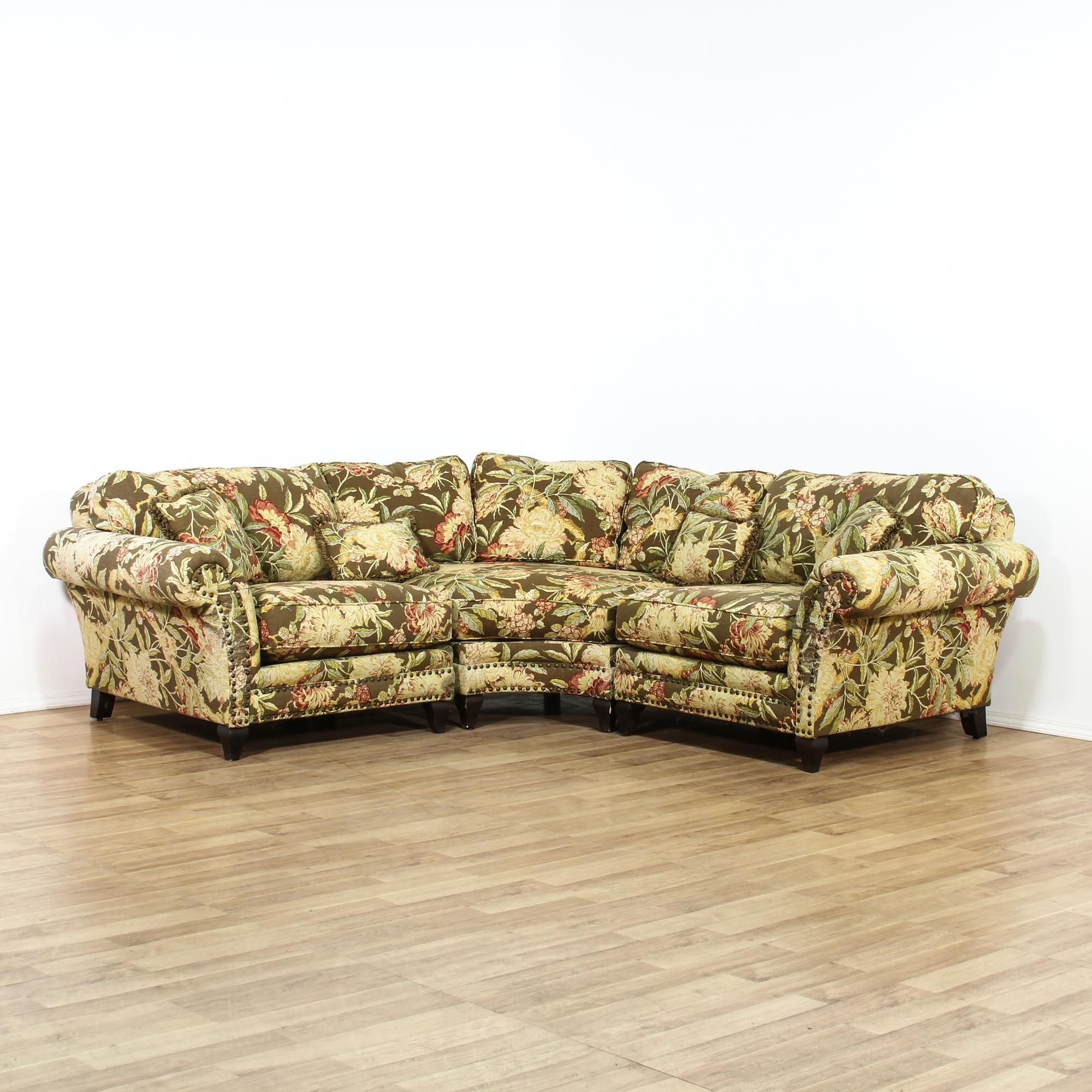 This sectional sofa is upholstered in a tropical pattern This